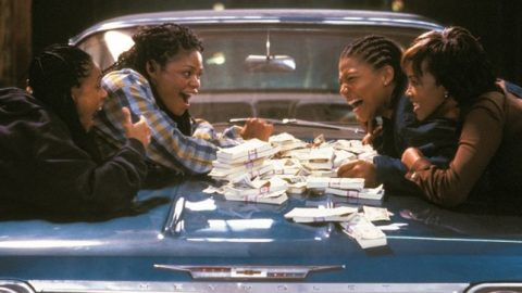 The four women, Stoney, T.T., Frankie and Cleo lean over the hood of cleo's car with a pile of money between them.