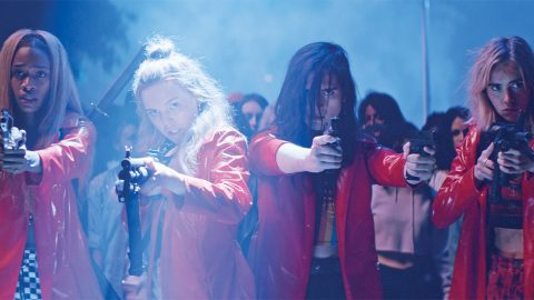 Abra, Odessa Young, Hari Nef and Suki Waterhouse appear in Assassination Nation by Sam Levinson. Dressed in their signature red raincoats designed and made by costume designer Rachel Dainer-Best
