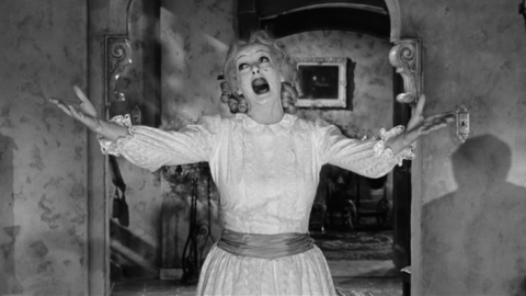 Bette Davis dress as Baby Jane singing I've Written a Letter To Daddy